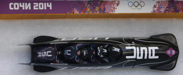 Pilot Steven Holcomb, Curtis Tomasevicz, Steven Langton and Christopher Fogt of the U.S. speed down the track during the four-man bobsleigh event at the Sochi 2014 Winter Olympics, at the Sanki Sliding Center in Rosa Khutor February 23, 2014. REUTERS/Fabrizio Bensch (RUSSIA - Tags: SPORT BOBSLEIGH OLYMPICS)