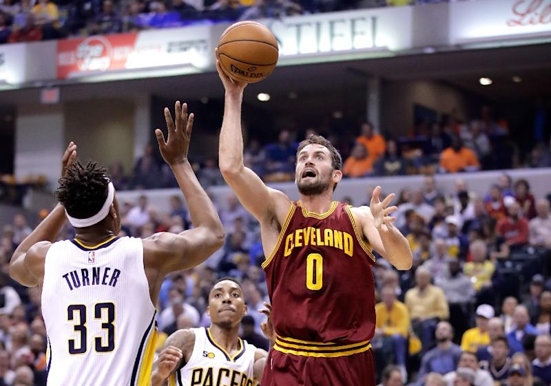 In Cleveland, Kevin Love remained hot from the three-point line as the Cleveland Cavaliers routed the Dallas Mavericks 128-90 (AFP Photo/Andy Lyons)
