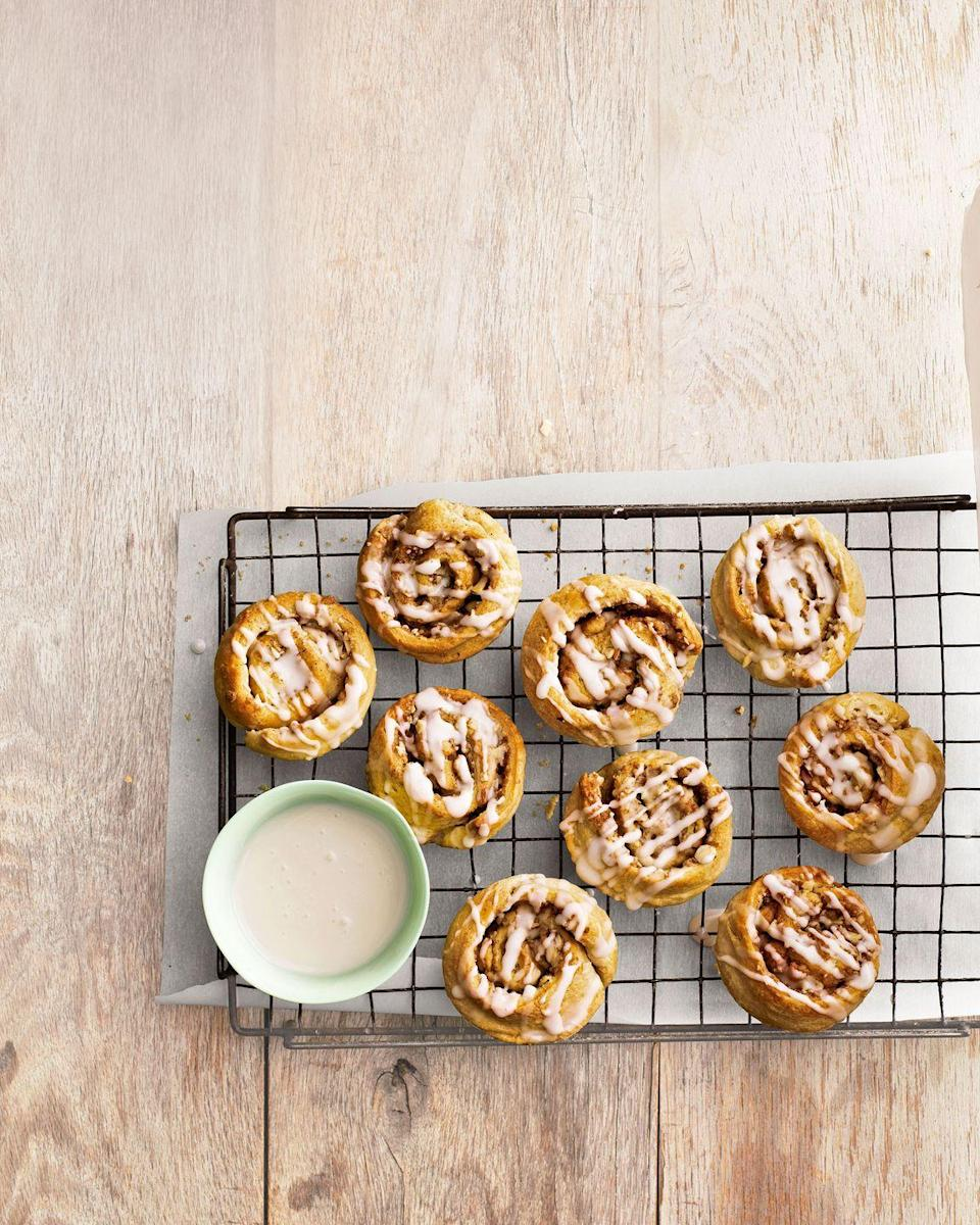 """<p>Allow mom to indulge with these irresistible cinnamon-scented pastries. </p><p><strong><a href=""""https://www.countryliving.com/food-drinks/recipes/a4786/almond-cinnamon-buns-recipe-clv0314/"""" rel=""""nofollow noopener"""" target=""""_blank"""" data-ylk=""""slk:Get the recipe"""" class=""""link rapid-noclick-resp"""">Get the recipe</a>.</strong><br></p><p><a class=""""link rapid-noclick-resp"""" href=""""https://www.amazon.com/Home-table-folding-breakfast-Bamboo/dp/B00PHS97EU/?tag=syn-yahoo-20&ascsubtag=%5Bartid%7C10050.g.1681%5Bsrc%7Cyahoo-us"""" rel=""""nofollow noopener"""" target=""""_blank"""" data-ylk=""""slk:SHOP BREAKFAST TRAYS"""">SHOP BREAKFAST TRAYS</a></p>"""
