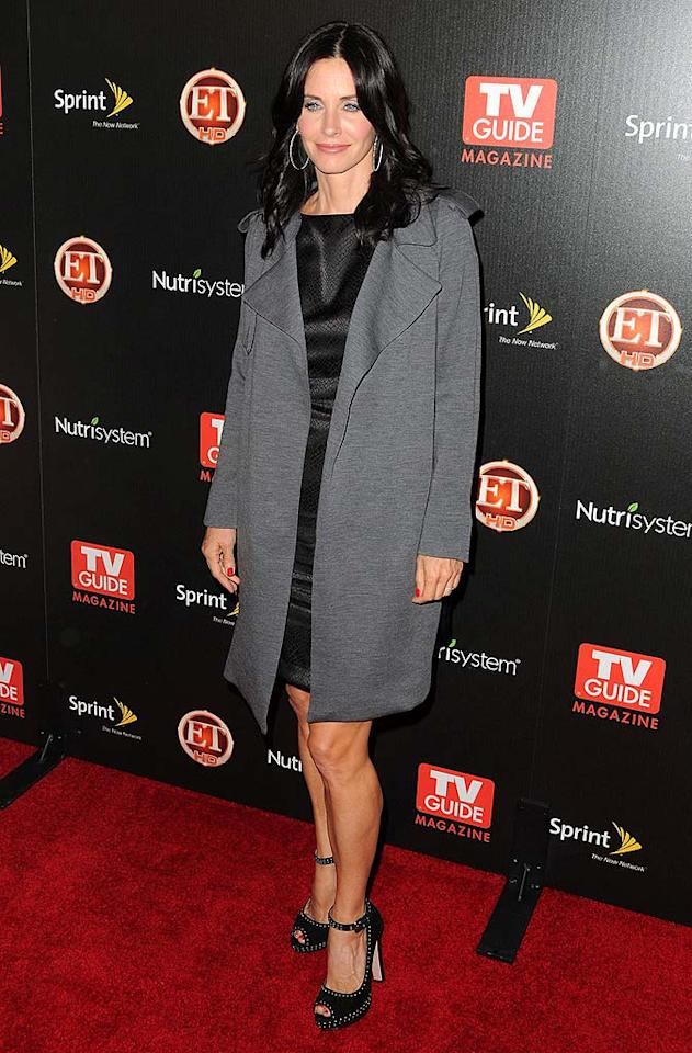 """Why is Courteney Cox smiling? It could be because her new show, """"Cougar Town,"""" got picked up for a full season last month, or maybe it's because former """"Friend"""" Lisa Kudrow is appearing on an upcoming episode. Jordan Strauss/<a href=""""http://www.wireimage.com"""" target=""""new"""">WireImage.com</a> - November 10, 2009"""