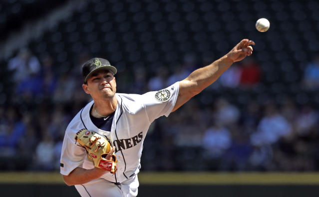 Seattle Mariners starting pitcher Marco Gonzales throws against the Texas Rangers in the first inning of a baseball game Monday, May 28, 2018, in Seattle. (AP Photo/Elaine Thompson)
