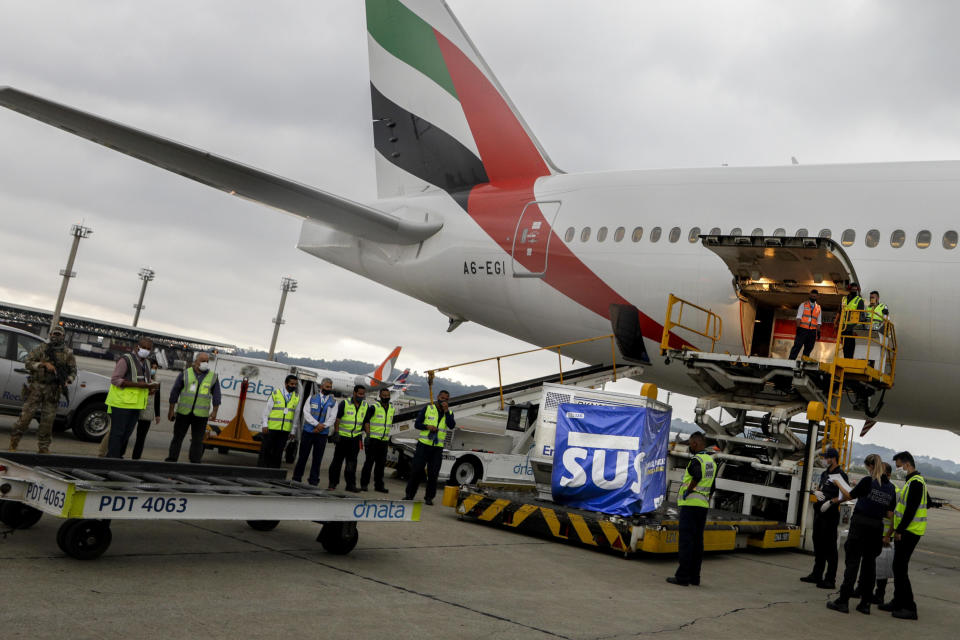 A container of vaccines against COVID-19 produced by Oxford/AstraZeneca arrives from India at the International airport in Sao Paulo, Brazil, Friday, Jan. 22, 2021. (AP Photo/Marcelo Chello)