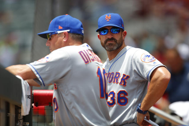 New York Mets manager Mickey Callaway (36) watches on alongside bench coach Gary Disarcina in the seventh inning of a baseball game against the Atlanta Braves, Wednesday, June 13, 2018, in Atlanta. The Atlanta Braves won the game 2-0. (AP Photo/Todd Kirkland)