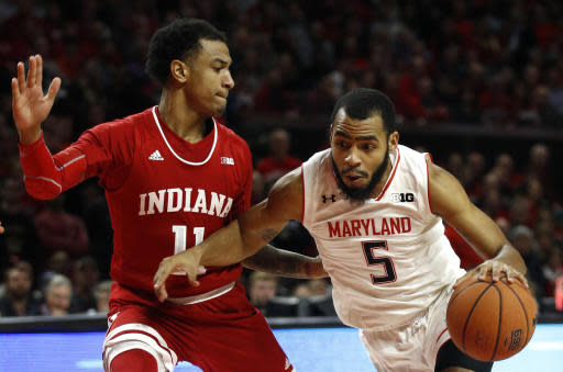 Maryland guard Eric Ayala, right, drives against Indiana guard Devonte Green in the second half of an NCAA college basketball game, Friday, Jan. 11, 2019, in College Park, Md. (AP Photo/Patrick Semansky)