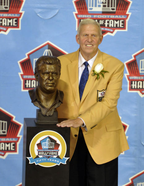 Hall of Fame inductee Bill Parcells poses with his bust during the 2013 Pro Football Hall of Fame Induction Ceremony Saturday, Aug. 3, 2013, in Canton, Ohio. (AP Photo/David Richard)