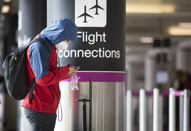 A passenger wearing face mask at a quiet Edinburgh airport during the coronavirus pandemic. (PA Images)