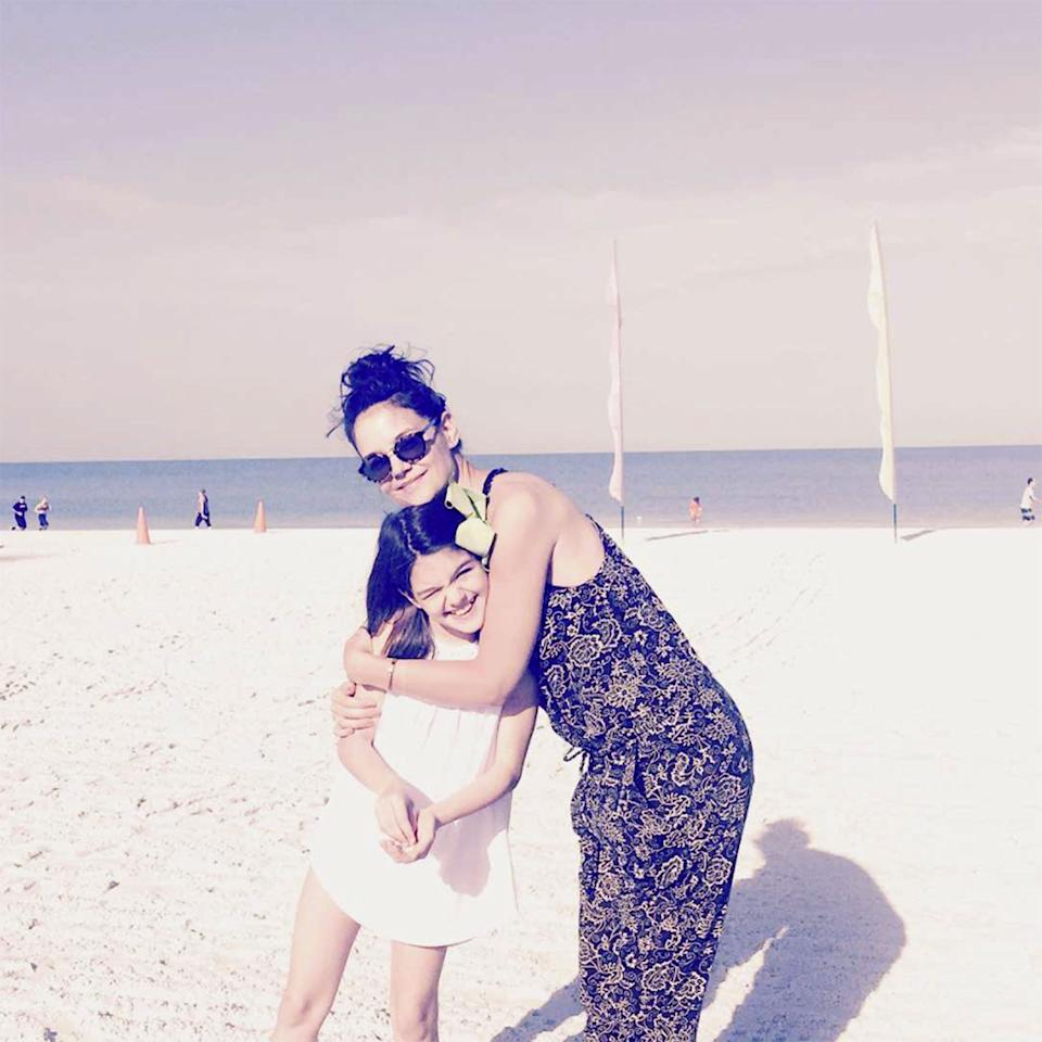 "<p>The mother-daughter duo know the right way to ring in spring — with <a rel=""nofollow"" href=""https://www.instagram.com/p/BS_rkitD74e/?taken-by=katieholmes212&hl=en"">a beach day that included a sweet photo shoot</a>.</p>"