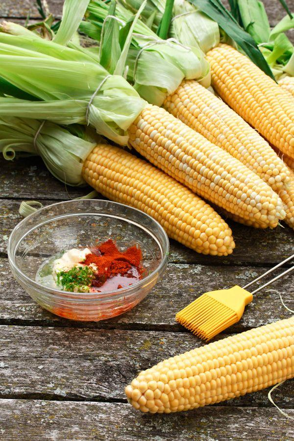 """<p>Covered in hot smoked paprika and lime juice, this corn on the cob will heat up any summer barbecue. </p><p><strong>Get the recipe at <a rel=""""nofollow"""" href=""""https://www.aspicyperspective.com/how-to-grill-corn/"""">A Spicy Perspective </a>.</strong></p>"""