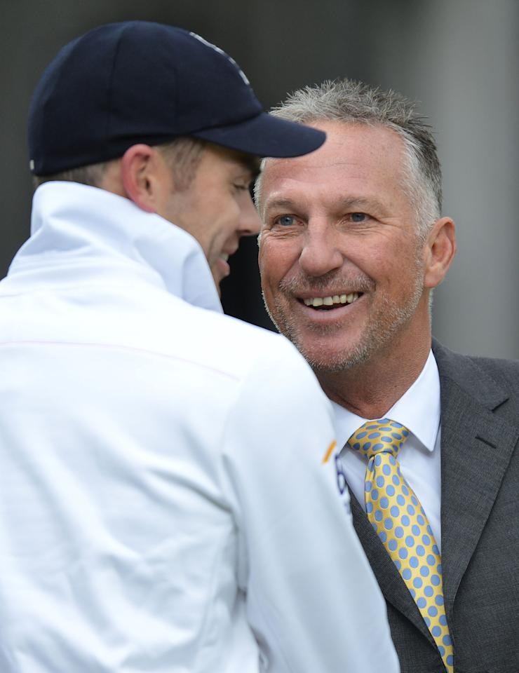 England's James Anderson is congratulated by Ian Botham after taking 300 test wickets during the first test at Lord's Cricket Ground, London.