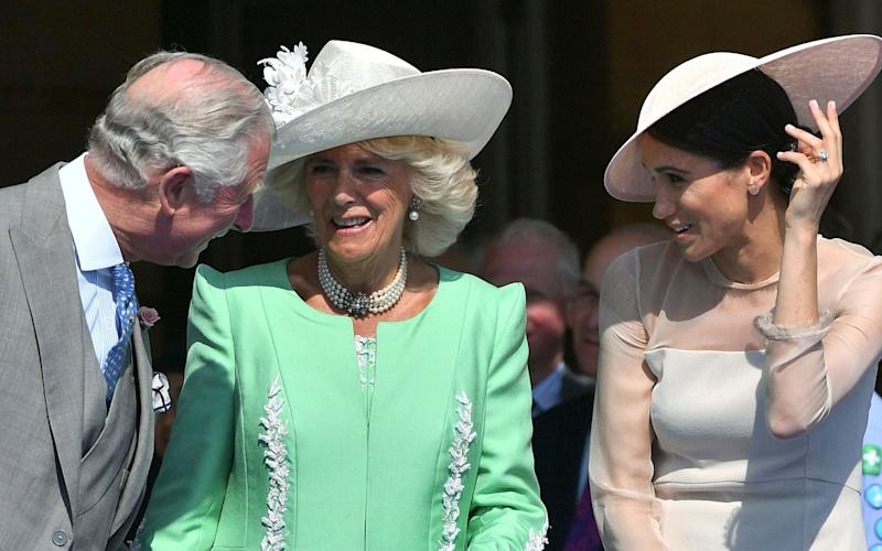 Prince Charles, with wife Camilla, the Duchess of Cornwal, and the Duchess of Sussex - Pool PA
