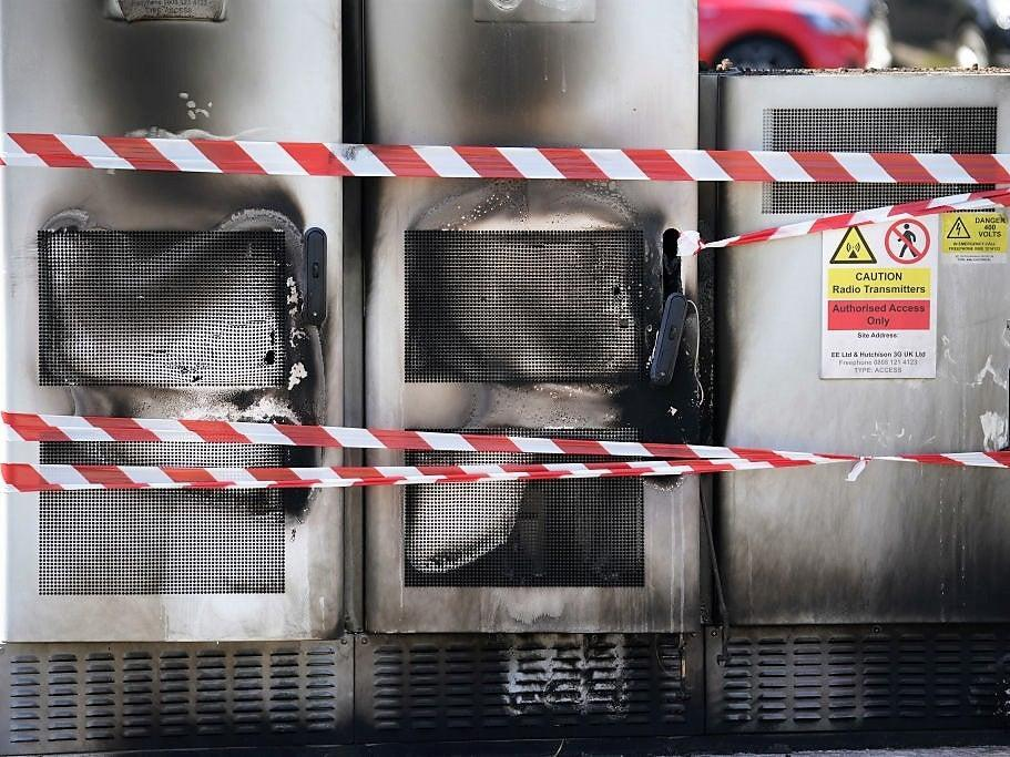 Fire and explosion damage can be seen on an EE network 5G mast that was attacked by an arsonist in Liverpool on 28 May, 2020  (Getty Images)