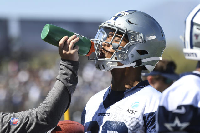 Dallas running back Tony Pollard is given a drink at the NFL football team's training camp in Oxnard, Calif., Saturday, July 27, 2019. (AP Photo/Michael Owen Baker)