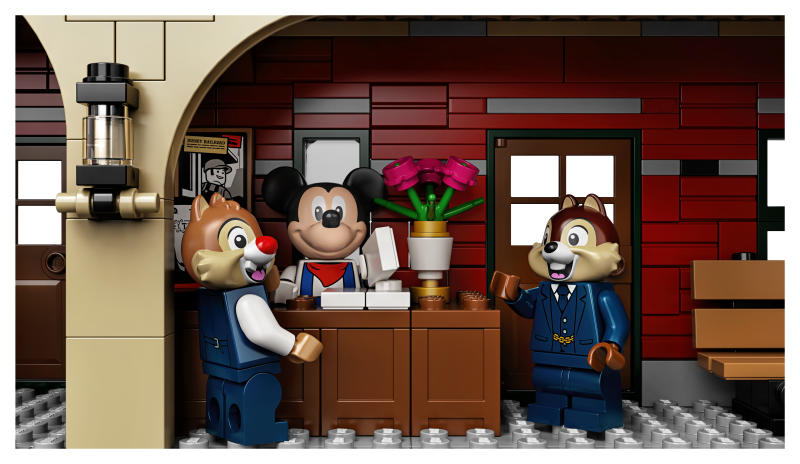 Mickey, Chip and Dale mingle at the train station. (Photo: Lego)