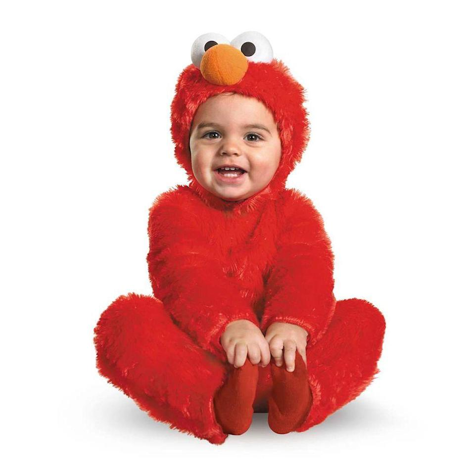 """<p><strong>Spirit Halloween</strong></p><p>spirithalloween.com</p><p><strong>$29.99</strong></p><p><a href=""""https://go.redirectingat.com?id=74968X1596630&url=https%3A%2F%2Fwww.spirithalloween.com%2Fproduct%2Ftoddler-elmo-one-piece-costume-seasame-street%2F38581.uts&sref=https%3A%2F%2Fwww.bestproducts.com%2Flifestyle%2Fnews%2Fg2996%2Fcute-halloween-costumes-for-toddlers%2F"""" rel=""""nofollow noopener"""" target=""""_blank"""" data-ylk=""""slk:Shop Now"""" class=""""link rapid-noclick-resp"""">Shop Now</a></p><p>Does it get any cuter than this toddler Halloween costume?</p><p>If your kid is a big fan of Elmo, he'll feel right at home dressing up in this costume. <a href=""""https://www.bestproducts.com/parenting/kids/g1121/best-toys-for-kids/"""" rel=""""nofollow noopener"""" target=""""_blank"""" data-ylk=""""slk:Give him a laughing Tickle Me Elmo toy"""" class=""""link rapid-noclick-resp"""">Give him a laughing Tickle Me Elmo toy</a> to walk around with, tell him to press Elmo's belly after someone gives him candy, and he'll get way more candy than all of the other trick-or-treaters!</p>"""