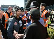 <p>Saffiyah Khan smiles defiantly at a protester in the United Kingdom that had assembled to spout anti-Islamic rhetoric as a part of the EDL initiative. </p>