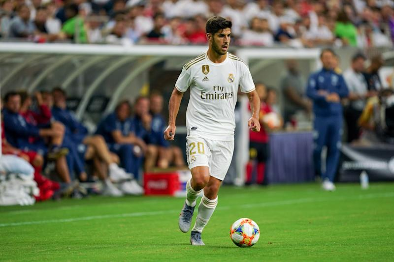 HOUSTON, TX - JULY 20: Real Madrid midfielder Marco Asensio (20) dribbles the ball during the International Champions Cup soccer match between FC Bayern and Real Madrid on July 20, 2019 at NRG Stadium in Houston, Texas. (Photo by Daniel Dunn/Icon Sportswire via Getty Images)