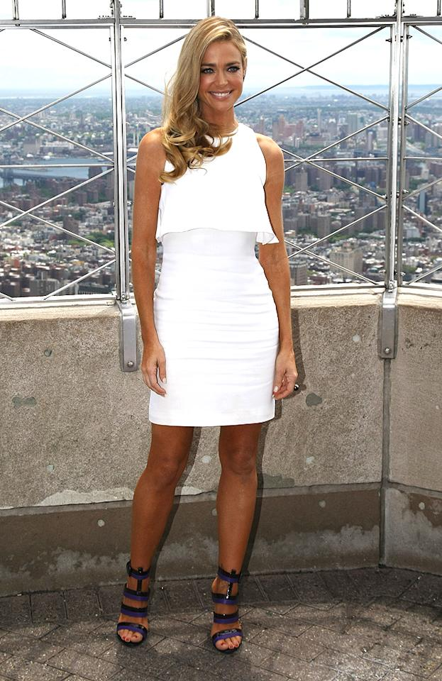 The following afternoon, Ms. Richards looked even more fresh and fabulous when she posed for photos atop the Empire State Building in this flirty white sheath and striking black-and-purple stilettos. Eat your heart out, Charlie!(6/26/2012)