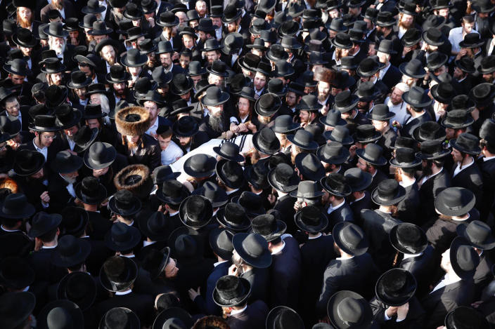 Mourners carry the body of a person who died during Lag BaOmer celebrations at Mt. Meron in northern Israel, at his funeral in Jerusalem on Friday, April 30, 2021. A stampede at a religious festival attended by tens of thousands of ultra-Orthodox Jews in northern Israel killed dozens of people and injured about 150 early Friday, medical officials said. It was one of the country's deadliest civilian disasters. (AP Photo/Ariel Schalit)