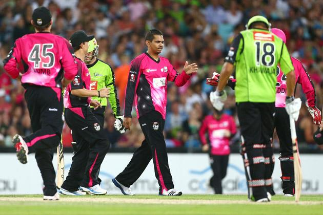 Sunil Narine of the Sixers celebrates with his team after taking a wicket during the Big Bash League match between Sydney Thunder and the Sydney Sixers at ANZ Stadium on December 30, 2012 in Sydney, Australia.  (Photo by Mark Kolbe/Getty Images)