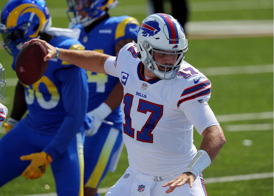 Josh Allen spikes the ball after a touchdown against the Los Angeles Rams.