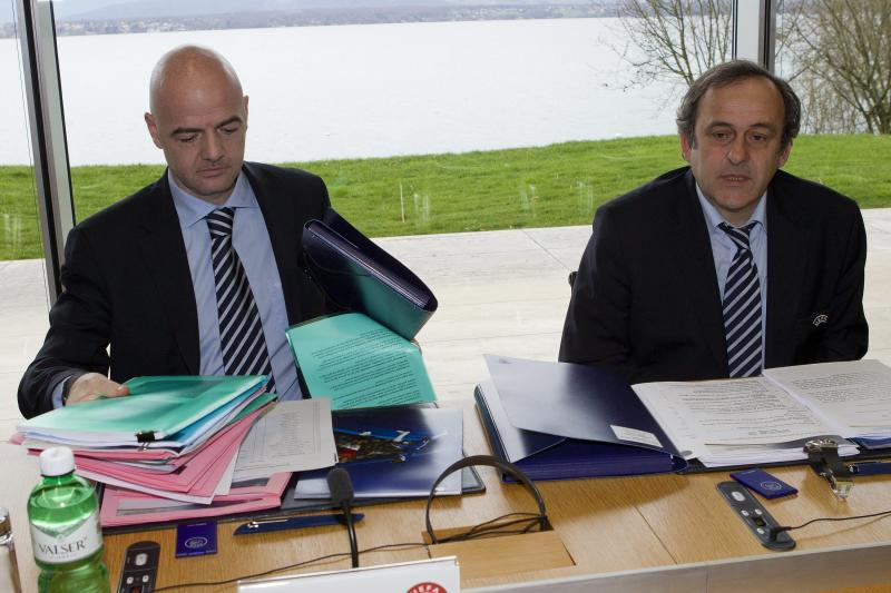UEFA President Michel Platini, right, sitting next to UEFA General Secretary Gianni Infantino, left, opens the UEFA Executive Committee at the UEFA Headquarters in Nyon, Switzerland, Tuesday, Jan.  24, 2012. (AP Photo/Keystone/Salvatore Di Nolfi)