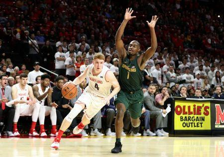 Jan 28, 2018; College Park, MD, USA; Maryland Terrapins guard Kevin Huerter (4) drives to the basket defended by Michigan State Spartans guard Joshua Langford (1) at XFINITY Center. Mandatory Credit: Mitch Stringer-USA TODAY Sports