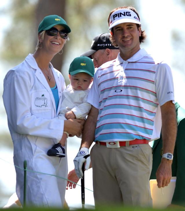 Bubba Watson of the US with his wife Angie and son Caleb during the Par 3 Contest held the day before the start of the 77th Masters golf tournament at Augusta National Golf Club on April 10, 2013 in Augusta, Georgia. AFP PHOTO / JIM WATSONJIM WATSON/AFP/Getty Images