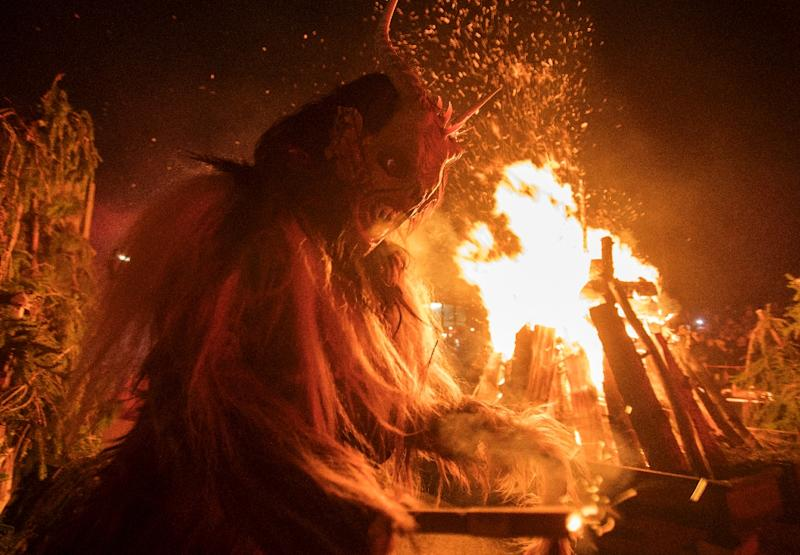 """Krampuslauf"" parades are a booming trade in Austria where the thrill of danger is part of the fun (AFP Photo/ALEX HALADA)"