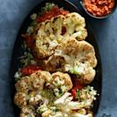 "<p>Use the entire cauliflower head--leaves (yes, they're edible), stem and florets and all for this healthy cauliflower main dish recipe. Be sure to not flip the cauliflower steaks as they roast, they get super-crispy and deliciously browned in the hot oven. <a href=""http://www.eatingwell.com/recipe/262127/cauliflower-steaks-with-parmesan-cauliflower-rice-romesco/"" rel=""nofollow noopener"" target=""_blank"" data-ylk=""slk:View recipe"" class=""link rapid-noclick-resp""> View recipe </a></p>"