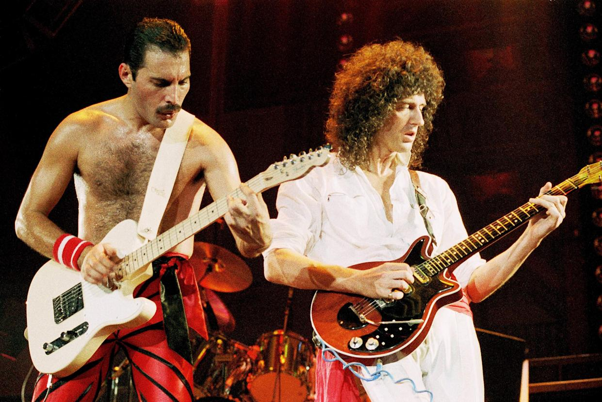 UNITED KINGDOM - SEPTEMBER 01:  WEMBLEY ARENA  Photo of QUEEN, Freddie Mercury and Brian May performing on stage  (Photo by Phil Dent/Redferns)