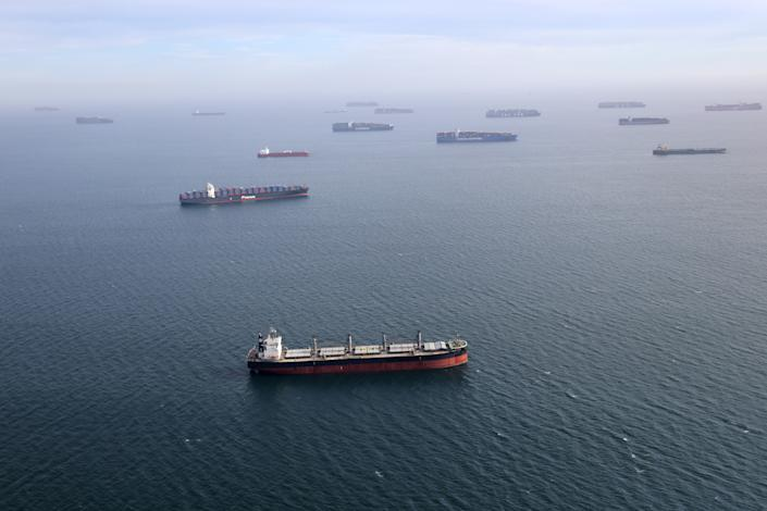 Container ships and oil tankers wait in the ocean outside the Port of Long Beach-Port of Los Angeles complex, amid the coronavirus disease (COVID-19) pandemic, in Los Angeles, California, U.S., April 7, 2021. REUTERS/Lucy Nicholson