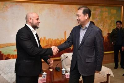 District Mayor Fan Shao Jun of the Baoshan local government (right) greets Eric K. Mangiardi, CEO of Q3 Medical Devices Limited (left) to discuss the future high-tech medical device manufacturing facility.