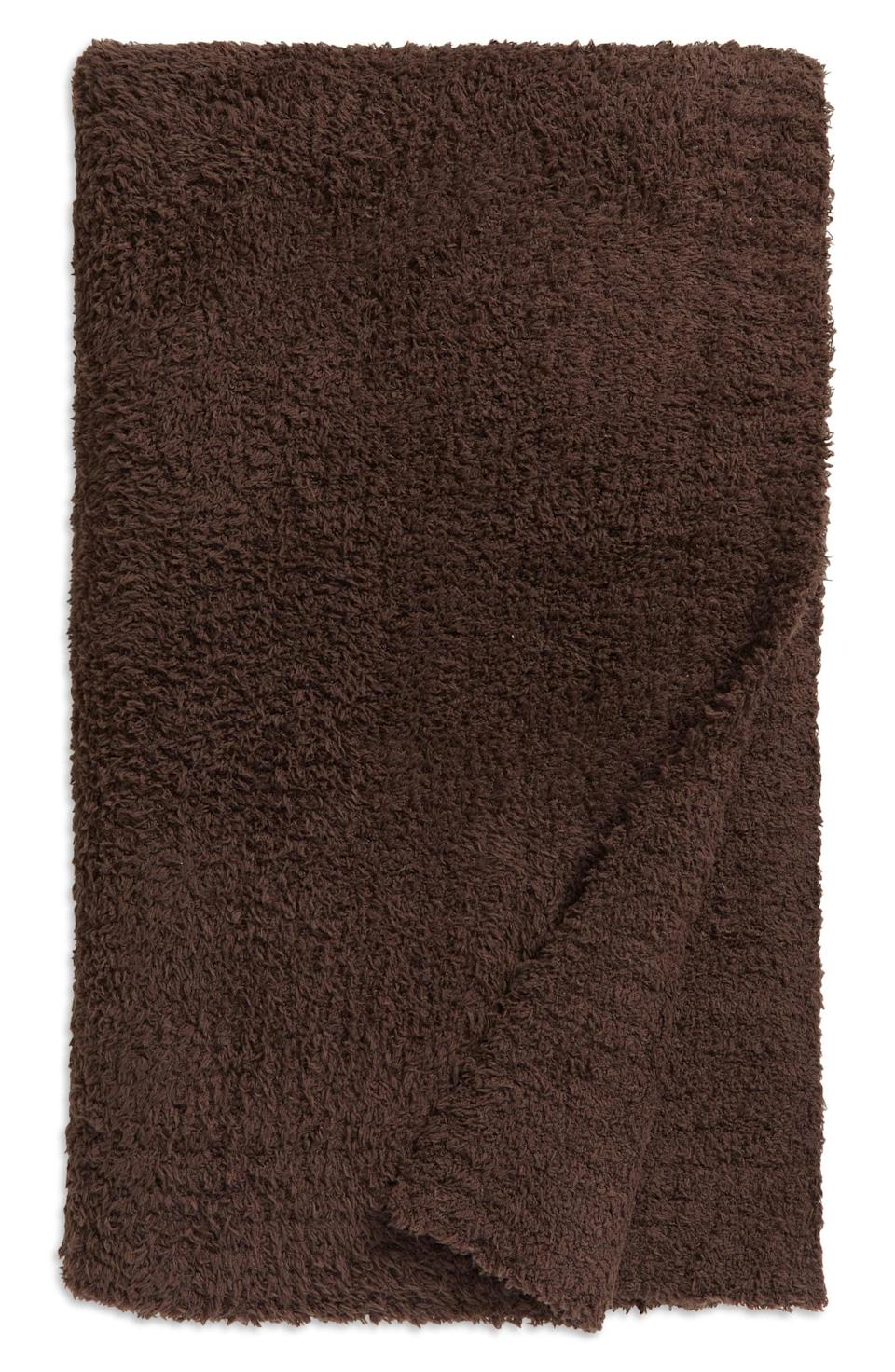 <p>Treat them to a slice of luxury with this ultra-soft, cuddle-worthy <span>Barefoot Dreams CozyChic Throw Blanket</span> ($147). It comes in a variety of colors and on't shrink, pill or wrinkle.</p>
