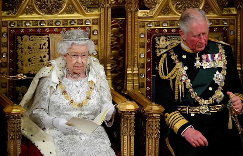 Britain's Queen Elizabeth II (L) sits with Britain's Prince Charles, Prince of Wales on the Sovereign's throne in the House of Lords as she delivers the Queen's Speech at the State Opening of Parliament in the Houses of Parliament in London on October 14, 2019. - The State Opening of Parliament is where Queen Elizabeth II performs her ceremonial duty of informing parliament about the government's agenda for the coming year in a Queen's Speech. (Photo by TOBY MELVILLE / POOL / AFP) (Photo by TOBY MELVILLE/POOL/AFP via Getty Images)