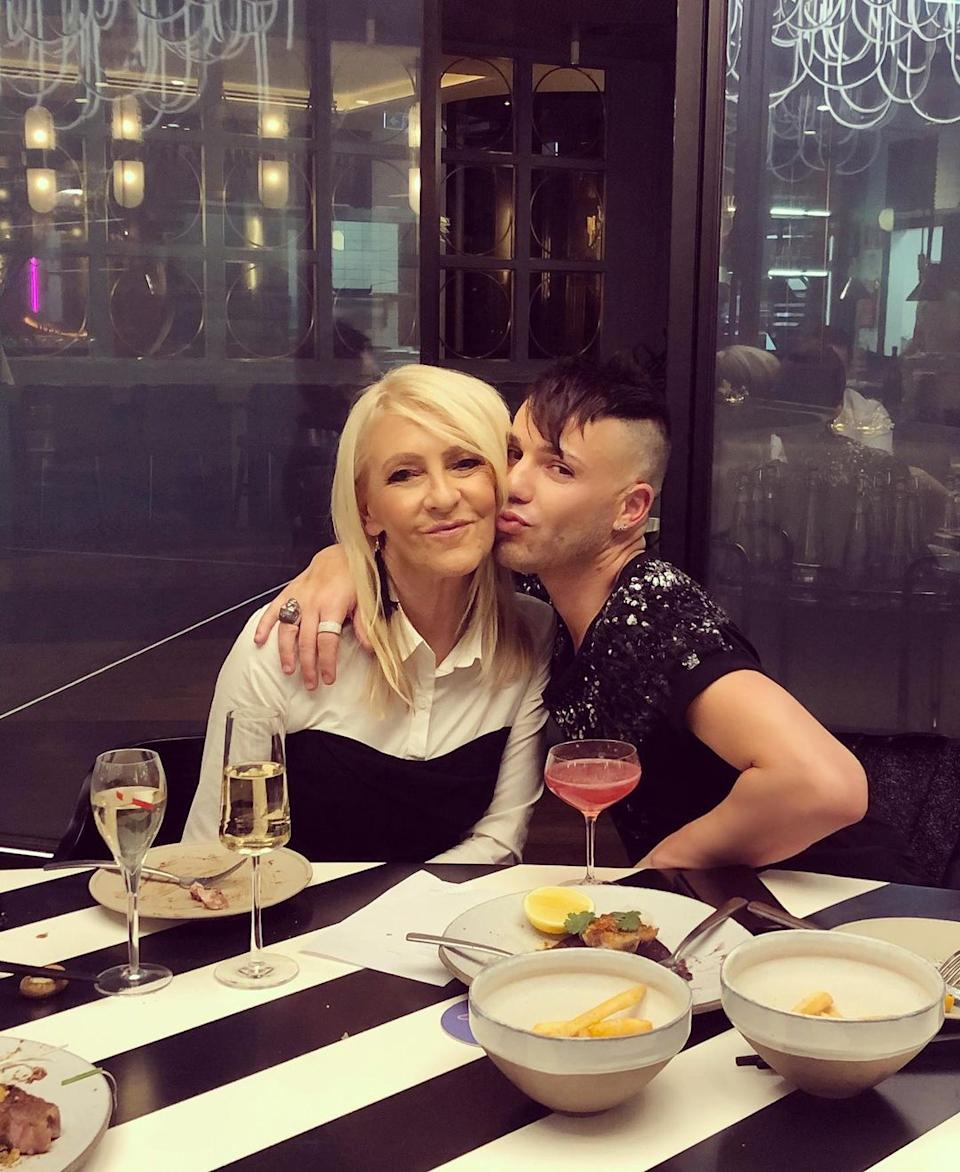 Anthony Callea hugs Jo Hill at a restaurant in Melbourne. Photo: Instagram/anthonycallea.