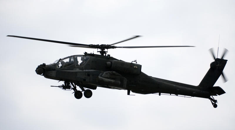 An Apache helicopter hovers on August 1, 2009 in Sparta, Kentucky