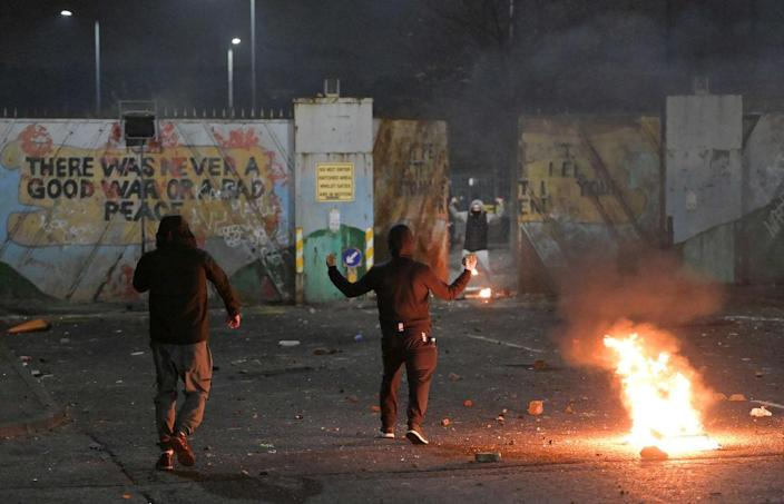 """Nationalists and Loyalists riot against one another at the Peace Wall interface gates which divide the two communities on April 7, 2021 in Belfast, Northern Ireland.<span class=""""copyright"""">Photo by Charles McQuillan/Getty Images</span>"""