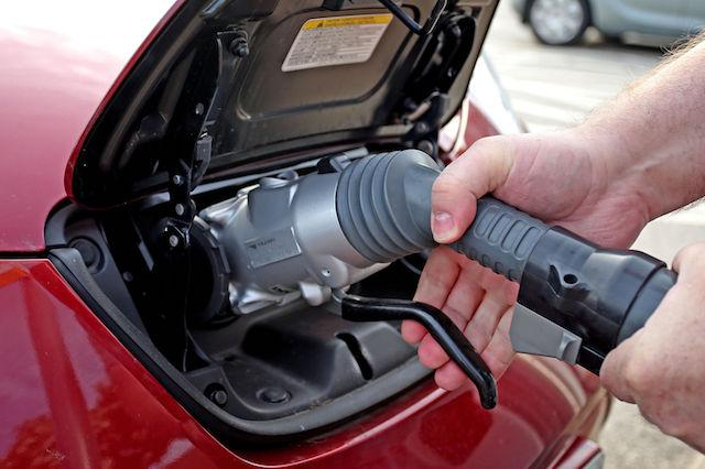 File photo dated 12/06/15 of a general view of an electric car charging point at Chester Services. New diesel and petrol cars and vans will be banned from 2040 as part of efforts to tackle air pollution, the Government is expected to announce.