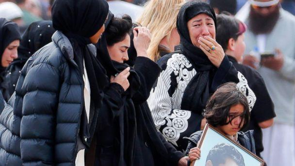 Mourners arrive for a burial service of a victim from the March 15 mosque shootings at the Memorial Park Cemetery in Christchurch, New Zealand, Thursday, March 21, 2019. (AP Photo/Vincent Thian) (The Associated Press)