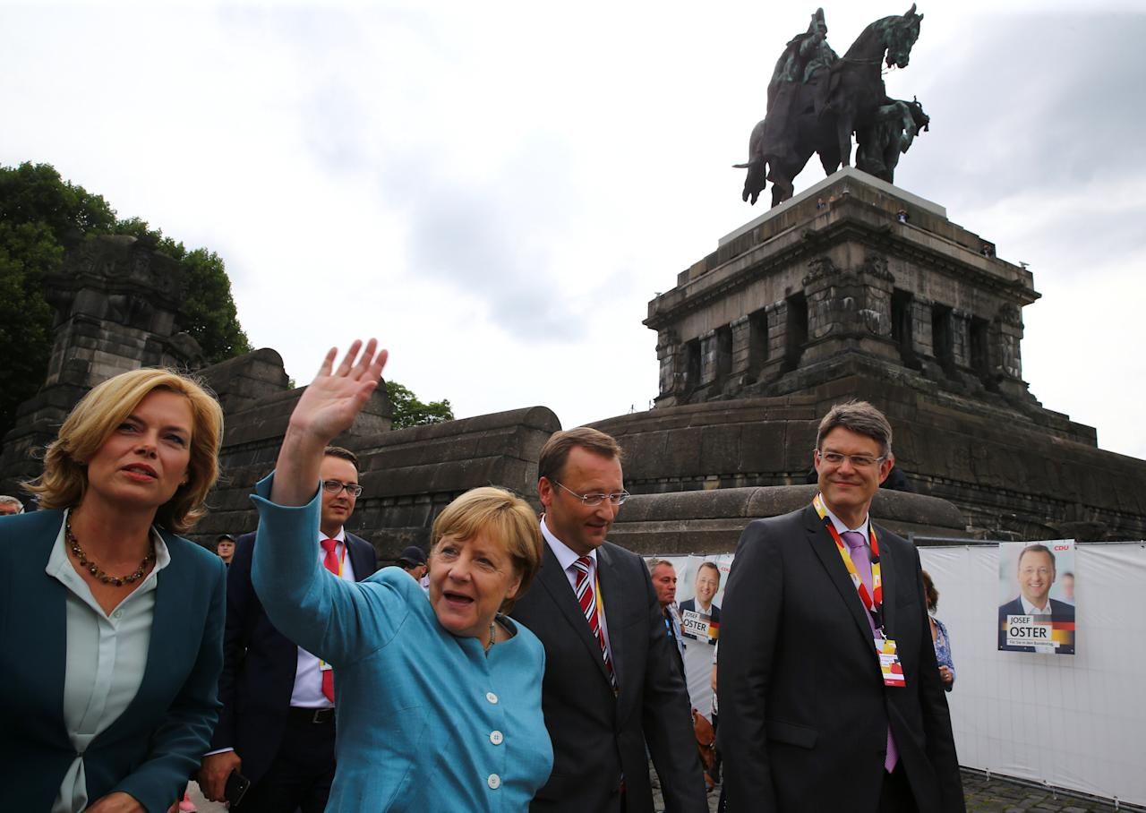 REFILE - CORRECTING TYPO German Chancellor Angela Merkel, top candidate of the Christian Democratic Union Party (CDU), waves as she arrives with Julia Kloeckner (L) for an election rally ahead the upcoming federal election, at the replica of the giant equestrian statue of former German Emperor William I atop of the German Corner (Deutsches Eck) at the confluence of the rivers Moselle and Rhine in Koblenz, Germany, August 16, 2017.  REUTERS/Wolfgang Rattay
