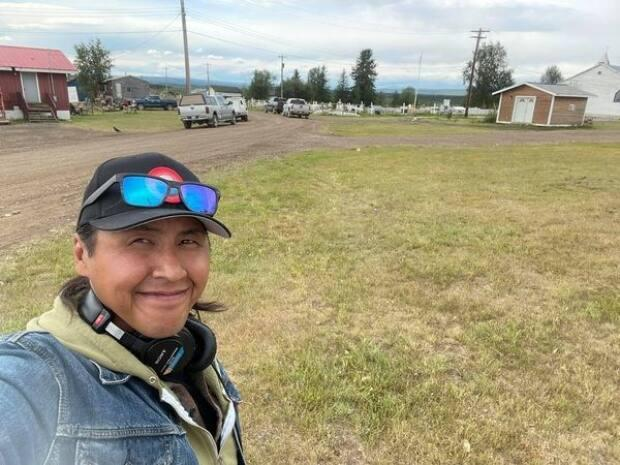 Lawrence Nayally, host of CBC North's Trails End, broadcast live from Fort McPherson, N.W.T., Wednesday. The community marked the 100th anniversary of Treaty 11 with a reenactment and gathering.  (Lawrence Nayally/CBC - image credit)