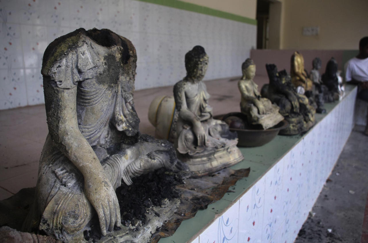 Damaged statues at a Buddhist temple that was torched in Ramu in the coastal district of Cox's Bazar, Bangladesh, Sunday, Sept. 30, 2012. Thousands of Bangladeshi Muslims angry over an alleged derogatory photo of the Islamic holy book Quran on Facebook set fires in at least 10 Buddhist temples and 40 homes near the southern border with Myanmar, authorities said Sunday. (AP Photo)