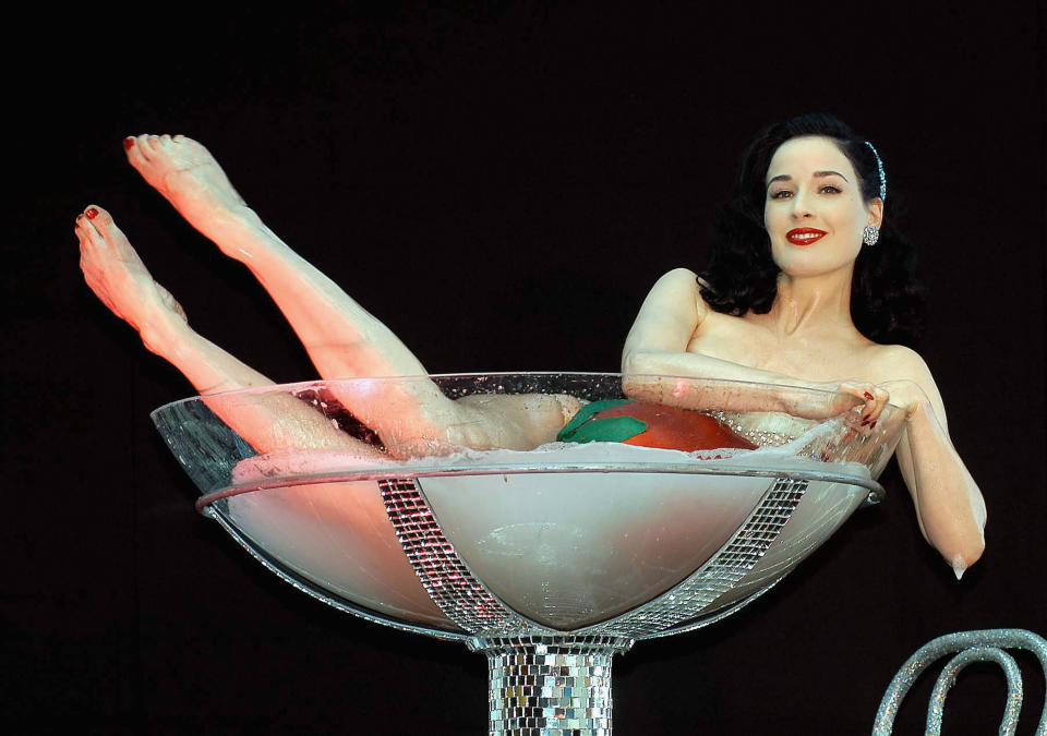 Dita Von Teese's famous champagne glass routine in 2005. (Photo: ShowBizIreland/Getty Images)