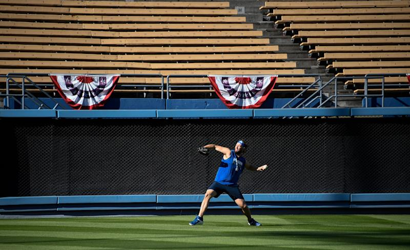Oct 2, 2019; Los Angeles, CA, USA; Los Angeles Dodger pitcher Clayton Kershaw throws in left field in an empty stadium the day before game 1 of the National League Divisional Series against the Washington Nationals. Mandatory Credit: Robert Hanashiro-USA TODAY Sports