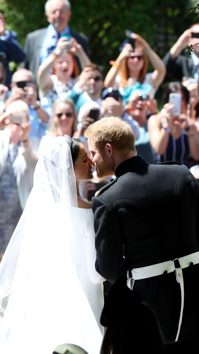 """<p>Maybe you woke up before the crack of dawn, or maybe you rolled out of bed <em>just</em> in time to witness the magic. Either way, Prince Harry and Meghan Markle's wedding was an unforgettable day. Now, two years after they said """"I do,"""" a lot of things are different for the couple. As royal fans know, Harry and Meghan are exactly royals anymore. In January, they announced they would be <a href=""""https://www.marieclaire.com/celebrity/a30445374/meghan-markle-prince-harry-resign/"""" rel=""""nofollow noopener"""" target=""""_blank"""" data-ylk=""""slk:stepping back from their senior royal duties"""" class=""""link rapid-noclick-resp"""">stepping back from their senior royal duties</a> to focus more on themselves and their son Archie. The change was a surprise to everyone; even <a href=""""https://www.marieclaire.com/celebrity/a31968827/prince-harry-meghan-meghan-royal-exit-email-the-queen/"""" rel=""""nofollow noopener"""" target=""""_blank"""" data-ylk=""""slk:the Queen"""" class=""""link rapid-noclick-resp"""">the Queen</a> wasn't expecting it. Now, settling into their new lives in Los Angeles and <a href=""""https://www.marieclaire.com/celebrity/a32182991/meghan-markle-prince-harry-delivered-food-los-angeles/"""" rel=""""nofollow noopener"""" target=""""_blank"""" data-ylk=""""slk:doing plenty of charity work"""" class=""""link rapid-noclick-resp"""">doing plenty of charity work</a>, they're taking it easy for a while.</p><p>But now that Harry and Meghan aren't royals anymore, we'e even more nostalgic. To celebrate one of our favorite couples, we found some of the <a href=""""https://www.marieclaire.com/celebrity/a30045958/meghan-harry-wedding-photographer-details/"""" rel=""""nofollow noopener"""" target=""""_blank"""" data-ylk=""""slk:cutest photos"""" class=""""link rapid-noclick-resp"""">cutest photos </a>you may have missed when they tied the knot on May 19, 2018. Prepare to shed a tear (or five).</p>"""