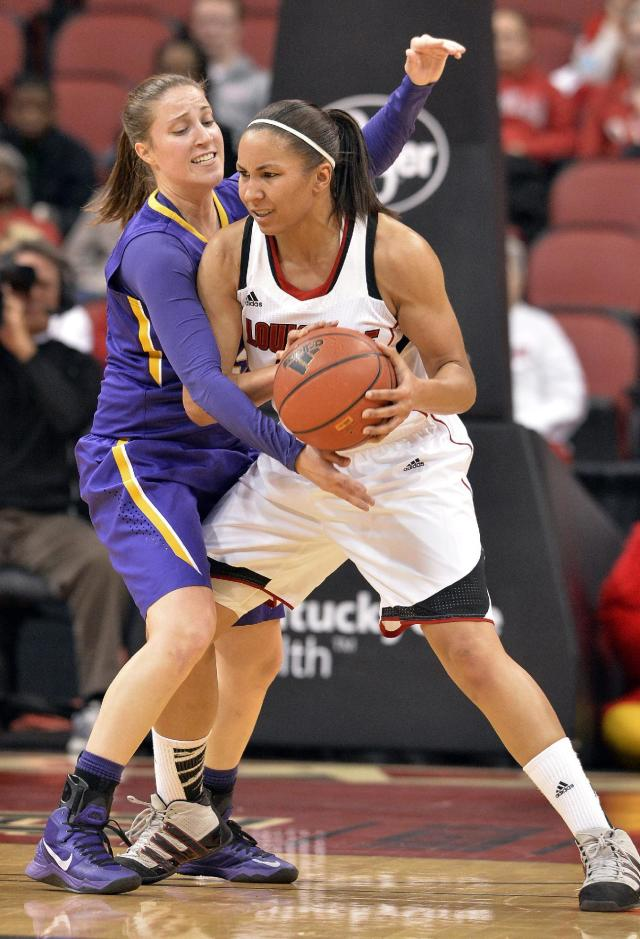 Louisville's Tia Gibbs, right, looks for help from the defensive pressure of LSU's Jeanne Kenney during the first half of an NCAA college basketball game on Thursday, Nov. 14, 2013, in Louisville, Ky. (AP Photo/Timothy D. Easley)