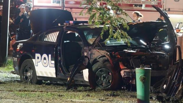Two Montreal police officers were taken to hospital after the car they were driving collided with the car of a woman in downtown Montreal Saturday night. (Stéphane Grégoire/Radio-Canada - image credit)