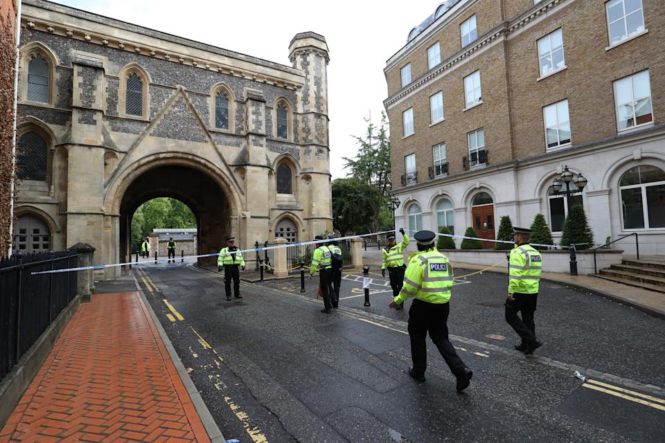 Police at the Abbey gateway of Forbury Gardens in Reading town centre following a multiple stabbing attack in the gardens which took place at around 7pm on Saturday leaving three people dead and another three seriously injured.