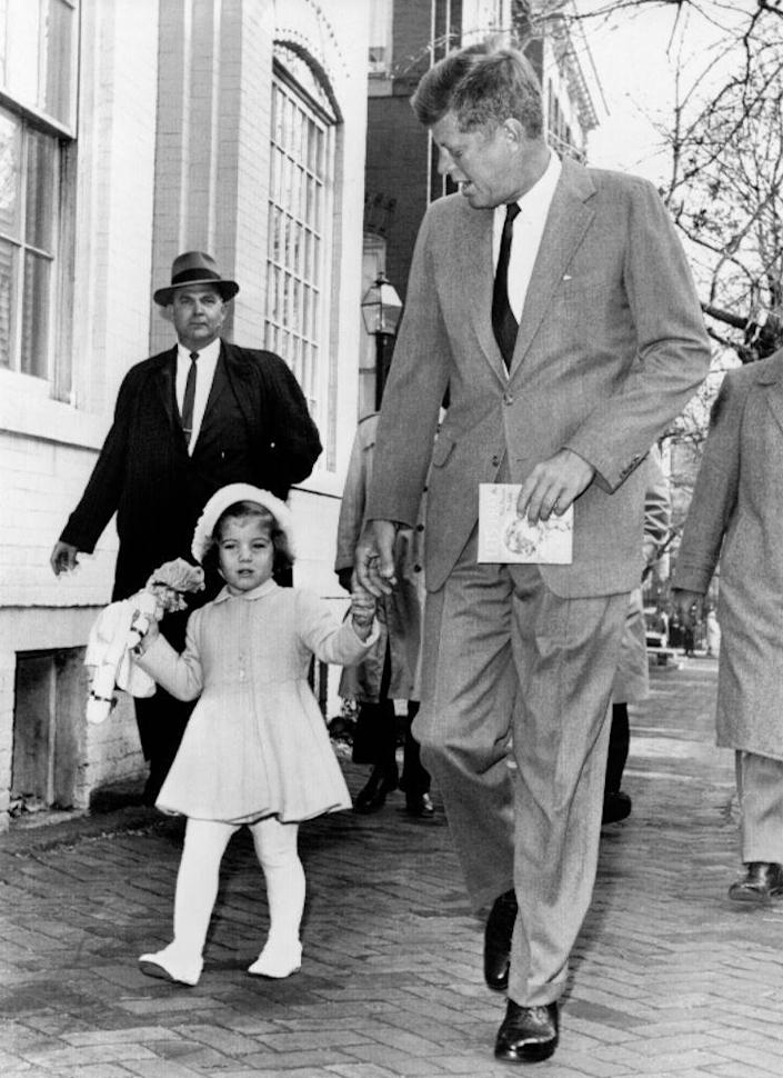 <p>President-elect Kennedy walks with Caroline on their way to church services on her third birthday in November.</p>
