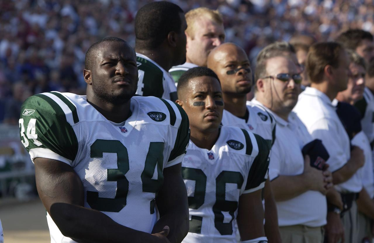 LaMont Jordan #34 of the New York Jets stands with his teammates during a pregame ceremony honoring those fallen in the World Trade Center tragedy before the game against the New England Patriots at Foxboro Stadium in Foxboro, Massachusetts. The Jets won 10-3. DIGITAL IMAGE. Mandatory Credit: Ezra Shaw/ALLSPORT